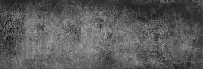 Textur einer fast schwarzen, strukturierten, alten Betonwand, als Hintergrund