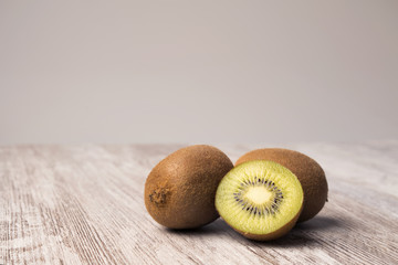 Kiwis and paper textured background