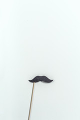 mustache photo prop on a table