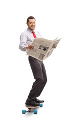 Businessman holding a newspaper and riding a longboard
