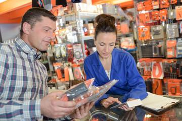 female assisting male customer