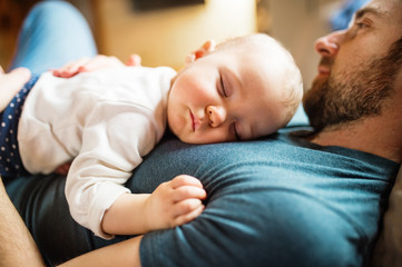 Wall Mural - Father with a baby girl at home sleeping.