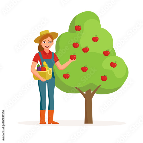 303eaa2b492d4f Woman farmer near apple tree holding ripe red apple and smiling with bucket  of vegetables.