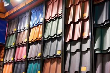 Samples of metal tiles roof in building store