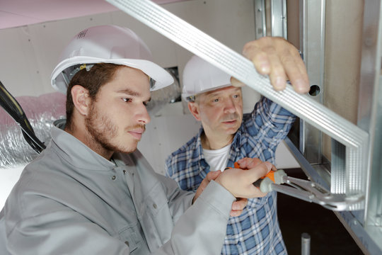 builders installing frame house structural insulated panel