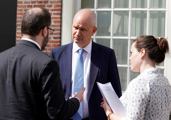 Britain's ambassador Peter Wilson speaks to embassy employees after a news conference at the British Embassy in the Hague