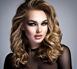 Beautiful blonde girl with  makeup in style smoky eyes.
