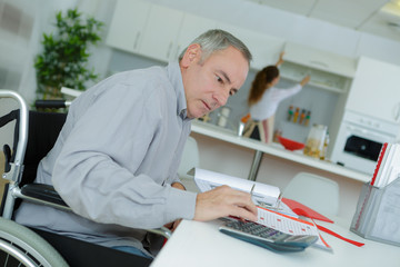handicapped man on wheelchair working from home