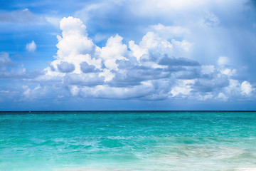 Panorama of the ocean with beautiful water colors and blue sky