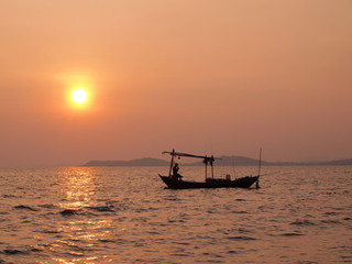 Beautiful sunset over the sea and Fishing boat