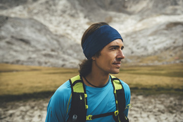 Portrait of a trail runner in the meadows in Picos de Europa Natural Park, Asturias, Spain