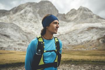 Portrait of a trail runner in the meadows in Picos de Europa Natural Park, Asturias, Spain