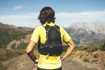 Back view of utra trail runner lookintg to horizo  in Picos de Europa Natural Park, Asturias, Spain