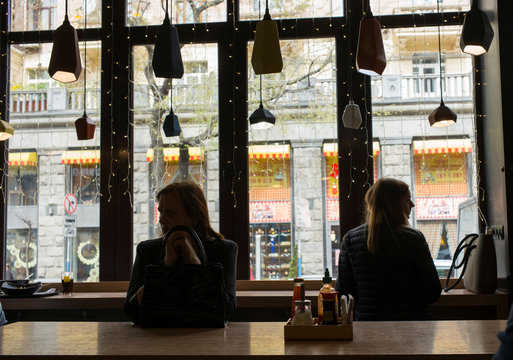 Women sit in a cafe as they wait to have their lunch in central Kiev