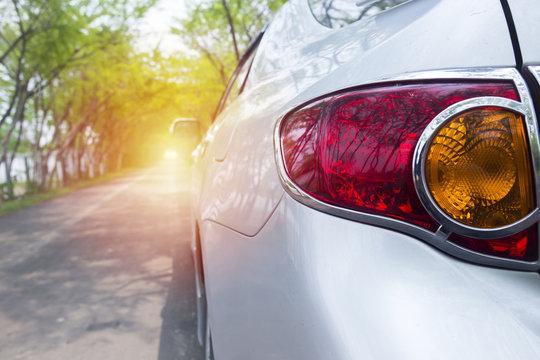 Back light car on green road,