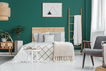 Poster in green bedroom interior