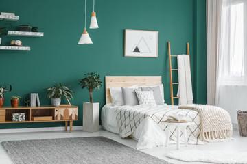 Green boho bedroom interior
