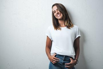 Beauty caucasian woman in white blank t-shirt, grunge wall, studio portrait Wall mural
