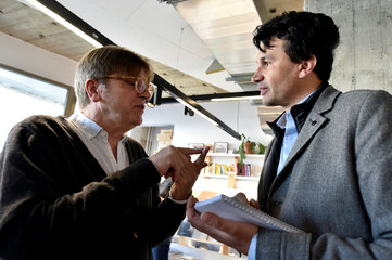 ALDE President and Former Belgium PM Verhofstadt chats with Reuters journalist Maushagen during the kick-off campaign of La Republique En Marche Benelux, in Brussels