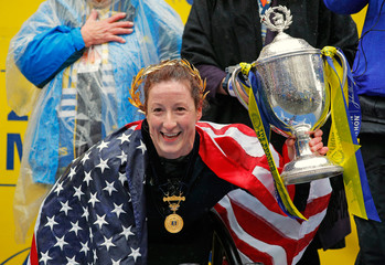 Tatyana Mcfadden of the U.S. celebrates after winning the women's wheelchair division of the 122nd Boston Marathon in Boston