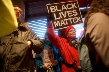 Protestor Sylvia Metzler demonstrates inside a Center City Starbucks, where two black men were arrested, in Philadelphia