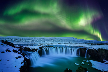Deurstickers Watervallen Northern Light, Aurora borealis at Godafoss waterfall in winter, Iceland.