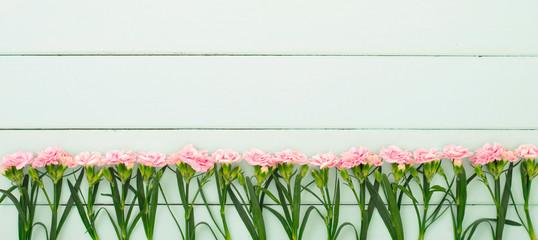 fresh carnation flowers in the wooden board