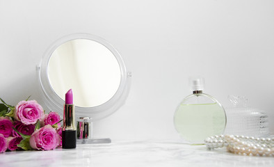 women's accessories on table in the bathroom with a mirror and cosmetics