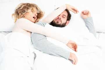 Snore. Couple sleep together in bed
