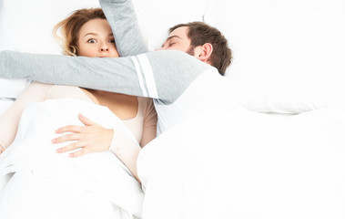 Couple sleep together in bed