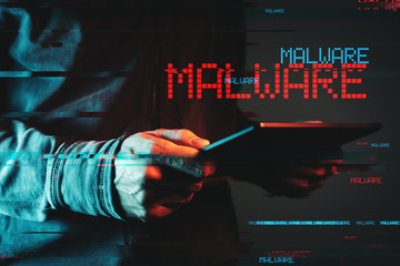 Malware concept with person using tablet computer