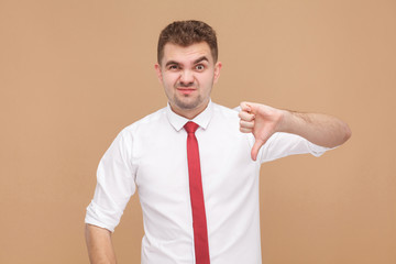Businessman showing dislike sign