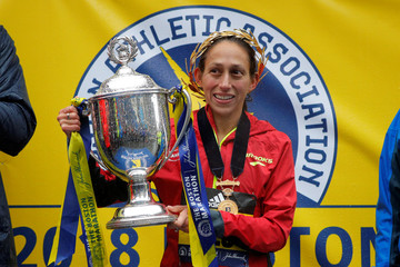 Desiree Linden of the U.S. celebrates with the trophy after winning the women's division of the 122nd Boston Marathon in Boston