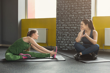 Two women exercising at fitness club