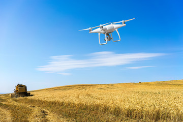 Controlling a remote helicopter drone. Drone flight remote controller in man hands. flying over fields