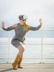 Woman wearing VR outside