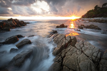 A fabulous sunset on a rocky bay in south of France