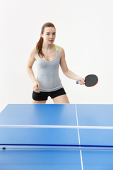 Sexy girl playing table tennis, isolated on white background