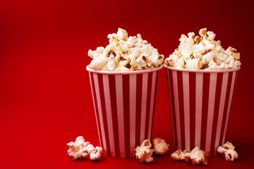 popcorn in two hollow boxes on a red background