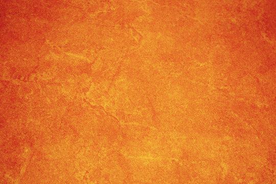 The texture of bright yellow-orange ceramic tiles