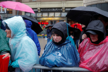 Spectators observe a moment of silence at the time and site of the bomb blasts on the 5th anniversary of the Boston Marathon bombings during the 122nd Boston Marathon in Boston