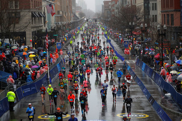 Runners approach the finish line on Boylston Street during the 122nd Boston Marathon in Boston