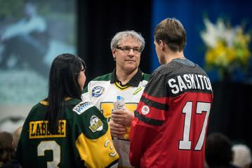 Saskatoon Mayor Clark speaks with attendees at a memorial celebration in Humboldt