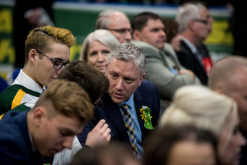 Humboldt Broncos team president Kevin Garinger speaks with attendees at a memorial celebration for Evan Thomas, one of the players killed in the bus crash carrying the Humboldt Broncos Junior A hockey team