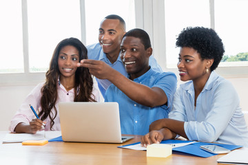 Laughing african american businessteam at office