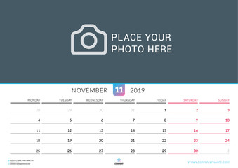 Wall calendar for November 2019. Vector design print template with place for photo. Week starts on Monday. Landscape orientation