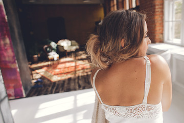 portrait from back of sexy woman dresses white clothes