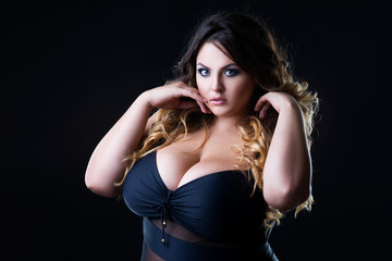 Plus size sexy fashion model in lingerie, fat woman with big natural breast on black studio background