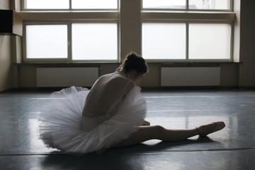 Young ballet dancer wearing pointe shoes in studio
