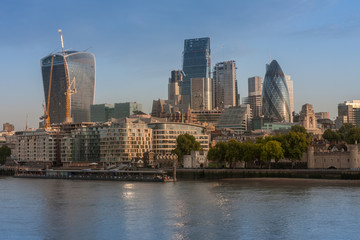 Thames embankment and london skyscrapers in City of London in the sunrise time